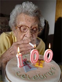 lighting-a-cigarette-off-a-100-candle-funny-old